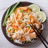 Salad of rice noodles with chicken, shrimp and vegetables Stock Images