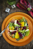 Salad with roasted beetroot, apple and pecans Stock Image