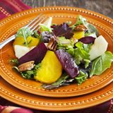 Salad with roasted beetroot, apple and pecans Royalty Free Stock Photo