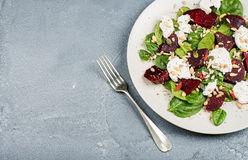 Salad with roasted beetroot, spinach, soft goat cheese and seeds Royalty Free Stock Images