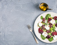 Salad with roasted beetroot, spinach, soft goat cheese and seeds Stock Photography