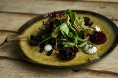 Salad with roasted beetroot, spinach, soft goat cheese stock photography