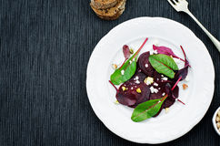 Salad with roasted beets, goat cheese, mangold and pistachios Royalty Free Stock Image