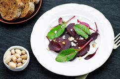 Salad with roasted beets, goat cheese, mangold and pistachios Royalty Free Stock Photography
