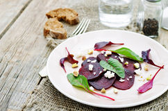 Salad with roasted beets, goat cheese, mangold and pistachios Stock Photo