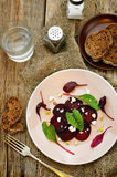 Salad with roasted beets, goat cheese, mangold and pistachios Stock Image