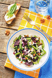 Salad with roasted beets, green beans, walnuts and goat cheese Royalty Free Stock Photo