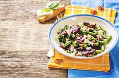 Salad with roasted beets, green beans, walnuts and goat cheese Stock Photos