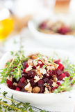 Salad of roasted beets and walnuts Royalty Free Stock Image