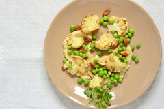 Salad with roasted cauliflower and green peas, almonds served on vegetable puree Stock Image