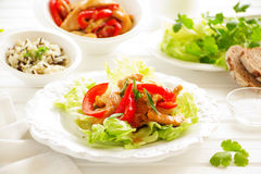 Salad with roasted chicken breast. Stock Images