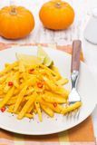 Salad of roasted pumpkin with lime and chilli on the plate Royalty Free Stock Images
