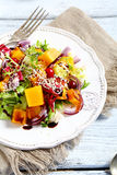 Salad with roasted pumpkin and sesame seeds Royalty Free Stock Photography