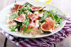 Salad. Rocket, feta, fig and prosciutto salad stock photography