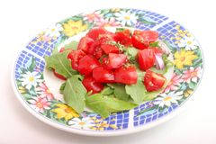 Salad of rocket with tomatoes Royalty Free Stock Photography