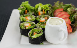 Salad roll. Close up shot of salad roll on the white dish Royalty Free Stock Photo