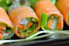 Salad roll healthy food on black plate royalty free stock image