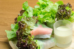 Salad roll vegetables and crab stick with salad dressing. In wooden plate Royalty Free Stock Photo