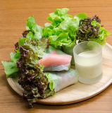 Salad roll vegetables and crab stick with salad dressing. In wooden plate royalty free stock images