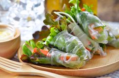 Salad rool healthy food on wood plate royalty free stock photo