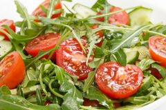 Salad from ruccola, cherry tomatoes and cucumber Stock Photo