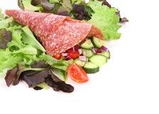 Salad with salami. Close up. Stock Images
