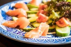 Salad salmon avocado Stock Images