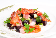 Salad with salmon, beet, potatoe, cucumber and. Cedrine nuts on the plate Royalty Free Stock Photography