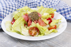 Salad with a salmon and cherry tomatoes Stock Photography