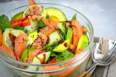 Salad with salmon, grapefruit and avocado. Royalty Free Stock Images