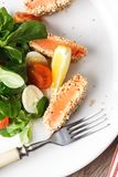 Salad with salmon grilled in sesame seeds, cherry tomatoes and quail egg on wooden table. Salad with salmon grilled in sesame seeds, cherry tomatoes and quail Stock Photo