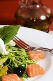 Salad with salmon and mascarpone cheese, pomelo leaves and lettuce Royalty Free Stock Photography