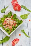 Salad with salmon and Mung bean sprouts. On a wooden board stock images