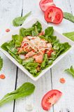 Salad with salmon and Mung bean sprouts. On a wooden board stock photo
