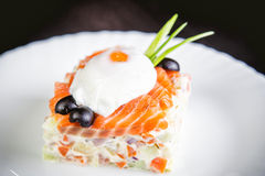Salad with salmon and poached egg, a tasty dish in the restaurant Royalty Free Stock Photography