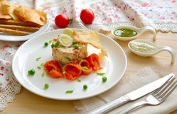 Salad with a salmon and quail egg Stock Images