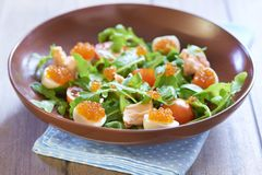 Salad with salmon, quail eggs, cherry tomatoes and red caviar Royalty Free Stock Image
