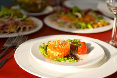 Salad with salmon and tomato. Salad with salmon on white plate Stock Photography