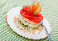 Salad of salmon with  tomatoes and Physalis Stock Photo