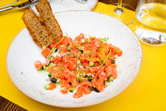 Salad with salmon, zucchini and onion. Seafood salad with rye bread in the restaurant Royalty Free Stock Photo