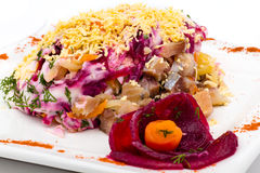 Salad with salted herring, potato, beet, carrot. And mayonnaise close up Stock Photography