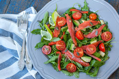 Salad with Salted salmon, herbs, tomatoes, avocado on a plate. Love for a healthy raw food concept Stock Photography