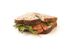 Salad Sandwich. A tomato, rocket and provolone cheese sandwich isolated on white Royalty Free Stock Images