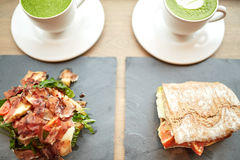Salad, sandwich and matcha green tea at restaurant Stock Photos
