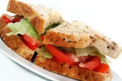 Salad Sandwich on Wholegrain Bread. A homemade salad sandwich on wholegrain bread, on a white plate, with white background stock image