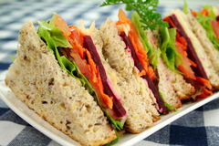 Salad Sandwiches. Fresh salad sandwiches cut into triangles ready to serve Royalty Free Stock Photography