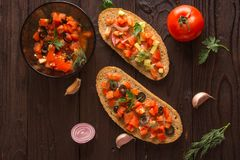 Salad sandwiches, tomato salad with olives and cucumber. Greenery. royalty free stock image