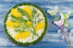 Salad with sardines Mimosas on a blue wooden background Stock Image
