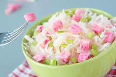 Salad of sauerkraut, pink radish and green onion Royalty Free Stock Image