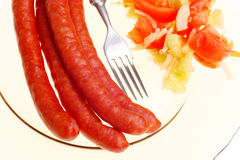 Salad sausage on plate isolated Royalty Free Stock Photo